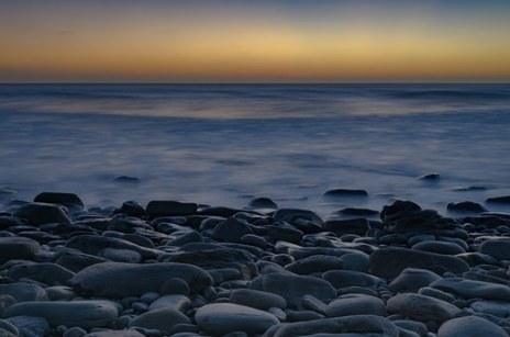 pebbles sea sunset